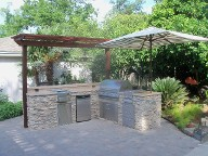 Houston, Texas outdoor kitchen, Brick Paver Patio, Retaining Wall, Drainage System, Fire Pit, Pergola