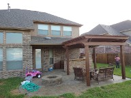 Pearland, Texas Pergola Brick Pavers Decking Drainage System Landscaping Outdoor Kitchen Lighting Fire Pit