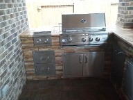 League City, Texas outdoor kitchen, Brick Paver Patio, Retaining Wall, Drainage System, Fire Pit, Pergola