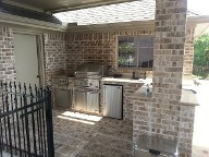 League City, Texas outdoor kitchen, Brick Paver Patio, Retaining Wall, Drainage System