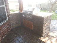 Pearland, Texas outdoor kitchen, Brick Paver Patio, Retaining Wall, Drainage System