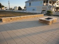 Galveston Island Fire Pit, Brick Paver Patio, Drainage System, Bench Seating, Retaining Wall, Landscape Lighting