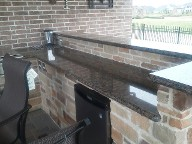Pearland, Texas Outdoor Kitchen Retaining Wall, Step System, Brick Paver Patio, Drainage System, Fire Pit, Fire Place